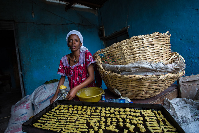 the pastry chef prepares the cookies to bake in harar
