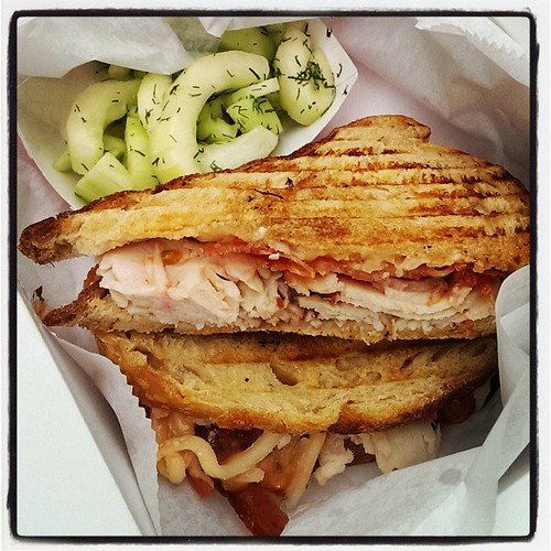 Turkey bacon cheddar tomato panini with cucumber salad, from Green Bean Mobile Cafe