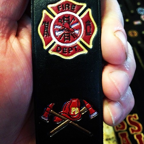 "Maltese cross and crossed axes - helmet on a 1.5"" radio strap."