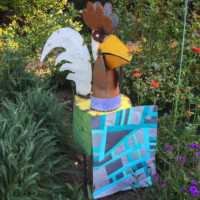 Garden photoshoot.  Since block one got to pose with a frog, it's only right block two gets to hang out with mr rooster. @quiltmatters #beesewcial #inspiredbybeesewcial #improvpiecing