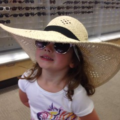 She still loves to try on #hats at #target. #goof #howdoyoulikemysunglases