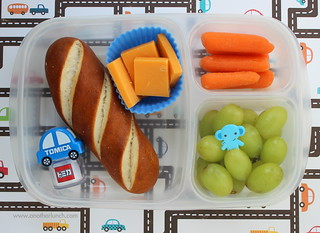 Soft pretzel, carrots, grapes, cheddar cheese - EasyLunchboxes & Tomica bento