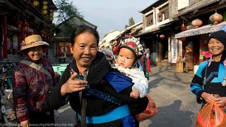 Ethnic ladies with baby Dali