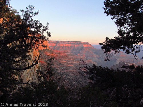 The sun finally rises, turning the cliffs orange and purple: the view from the Grandview Trail, Grand Canyon National Park, Arizona