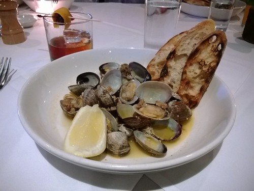 Wine Steamed Clams with Chorizo, Red Chili Flakes, and Baguette
