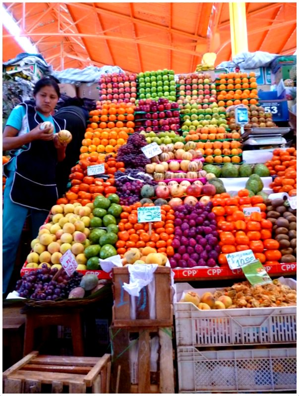 Fruit vendor at Mercado San Camilo