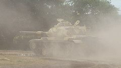 combat vehicle(1.0), weapon(1.0), vehicle(1.0), tank(1.0), military(1.0), mist(1.0), dust(1.0),
