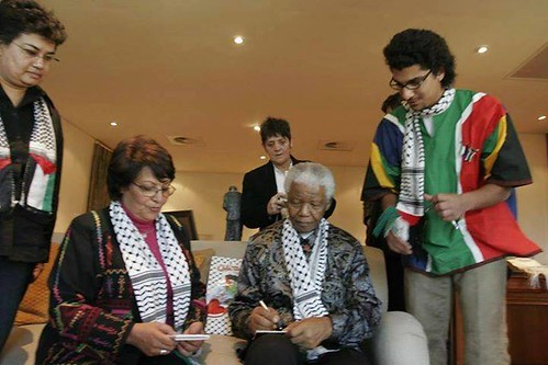 Nelson Mandela with members of the Popular Front for the Liberation of Palestine (PFLP). Mandela has been eulogized by the Palestinians. by Pan-African News Wire File Photos