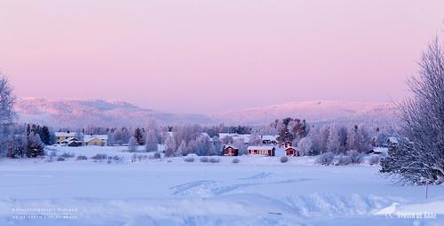 Pink sky over little settlement