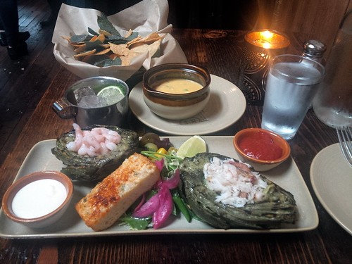 Clockwise from top: Queso and Chips, Woodhouse Grilled Artichoke, and Mezcal Mule