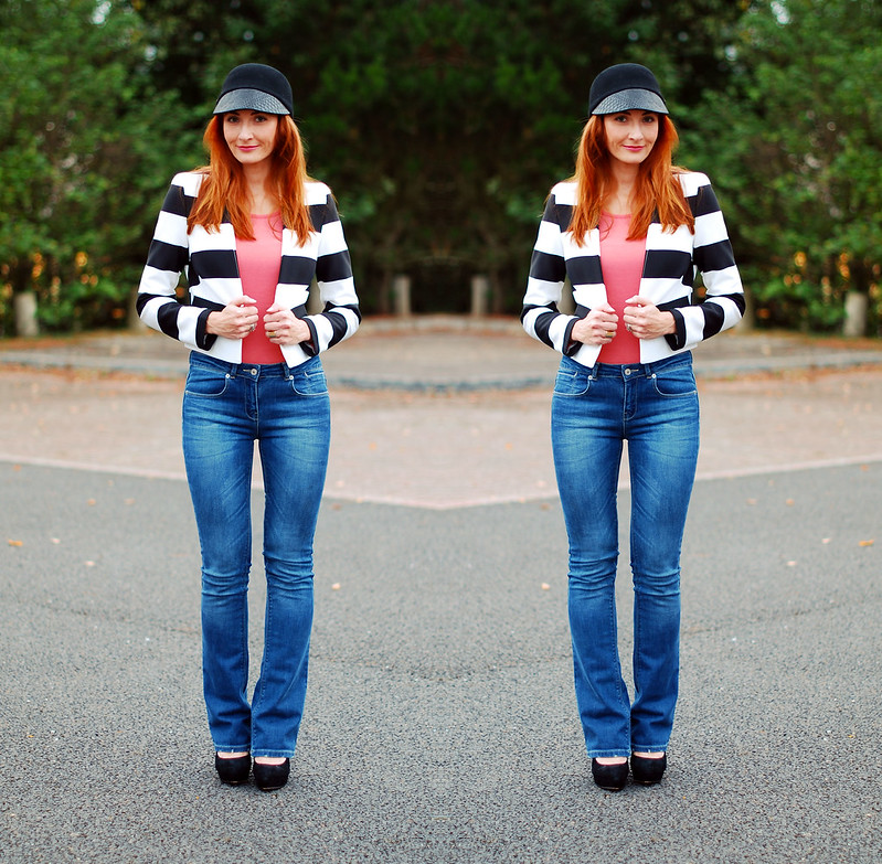 Black peak cap, black & white striped jacket and skinny flares
