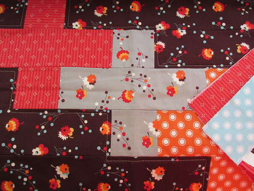 gorgeous mini quilt and fabric scraps from knausallison
