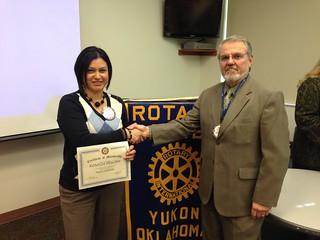 inducting a new member in Yukon, OK Rotary Club!