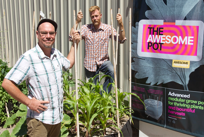 Sattva Ananda (L)  and John Cross (R) of Awesome Harvest, LLC with their patent-pending cloth growing pots (The Awesome Pot™).