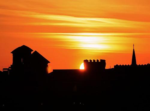 city sunset sun tower rooftop church silhouette downtown glow cross unitedstates florida flag roofline northflorida saintaugustineflorida towerpeek