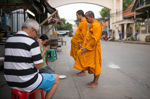 Monks are blessing to people who offering them food in the morning.