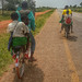Peter Gostelow posted a photo:Very common to see 3 or more people on a bicycle as form of taxi transport in rural Africa.