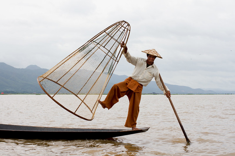 Fake fisherman posing for camera, Inle lake, Myanmar