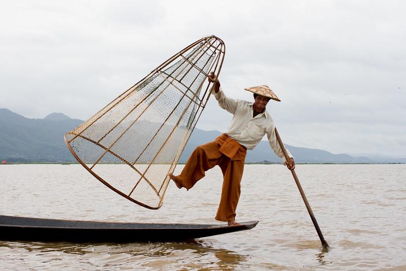 Fake fisherman posing for camera, Inle lake, Myanmar