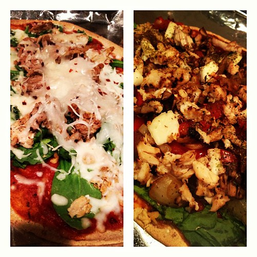 #pizzanight @williebeatfat prefers spinach ground turkey and cheese with red pepper flakes. Mine on the right: red bell peppers, onion, chicken, spinach, mushrooms, red pepper flakes. Both on #flatoutbread!