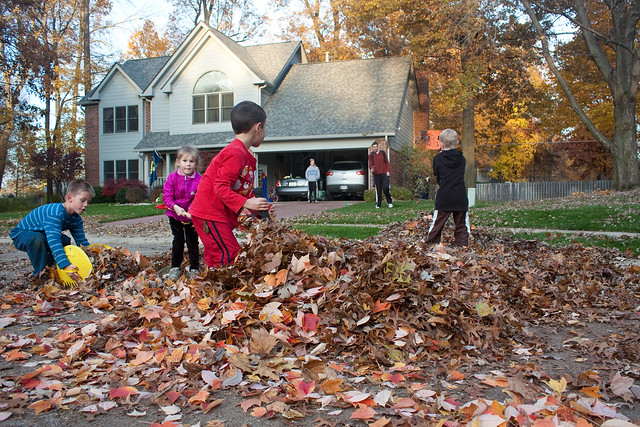 Kids playing in leaves via The Risky Kids