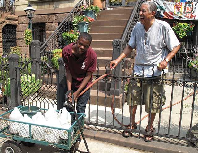A system for watering street trees, based on the efforts of their block's youth, helped this block, Bainbridge Street between Malcolm X Boulevard and Stuyvesant Avenue, become one of the Greenest Blocks in Brooklyn. Photo by GreenBridge staff.