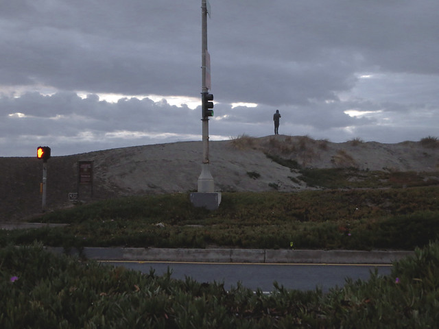 guy on cellphone at Ocean Beach POV Great Highway, San Franicsco (2014)