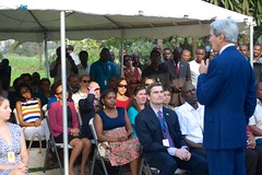 U.S. Secretary of State John Kerry speaks to staffers and family members at the U.S. Consulate General's Residence in Lagos, Nigeria, after the Secretary met with Nigerian President Goodluck Jonathan and his re-election challenger, retired Major-General Muhammadu Buhari, in Lagos on January 25, 2015, for conversations urging both candidates to accept the results of their upcoming general-election vote. [State Department Photo/Public Domain]