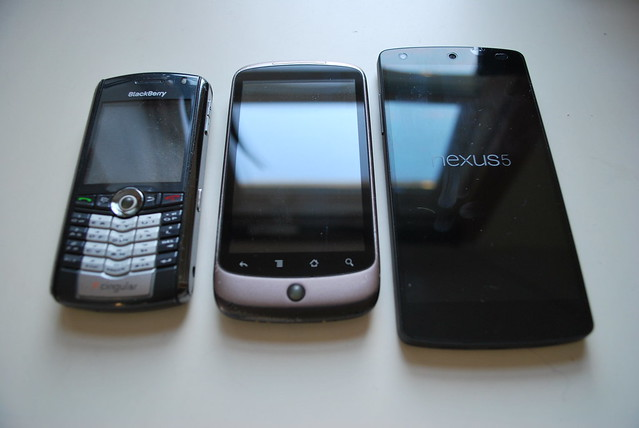 Blackberry Pearl 8100, HTC Nexus One, and LG Nexus 5 phones viewed from the front