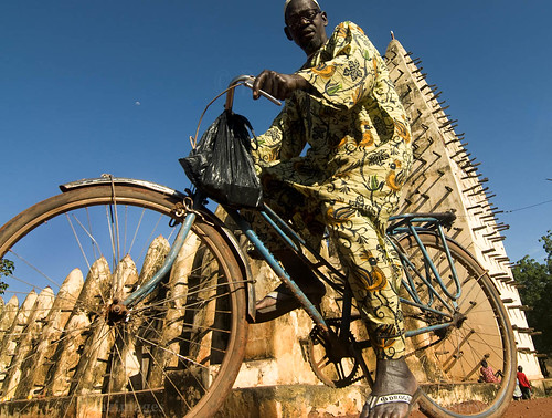 africa moon man male bicycle architecture muslim islam traditional culture documentary landmark mosque westafrica tradition burkinafaso sahel bobodioulasso sahelian burkiname