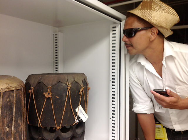 <p>The University of Hawaii delegation was treated to a special visit to the archives of the Smithsonian's Natural History and Anthropology Collections. Hawaii Community College Associate Professor Taupouri Tangaro gets a closer look at hula pahu from the early 1800s.</p>