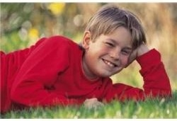 9 Year Old Boy Lying in Grass