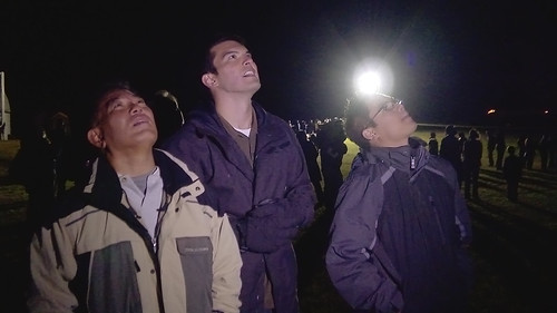 <p>Professor Wayne Shiroma and students Larry Martin and Windell Jones of the University of Hawai'i at Manoa College of Engineering watch the launch of the Air Force rocket carrying the satellite they helped build.</p>