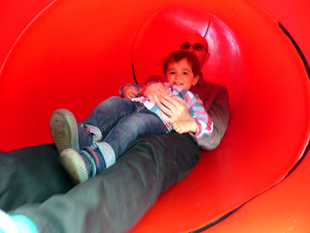 Sliding in the tunnel with Daddy