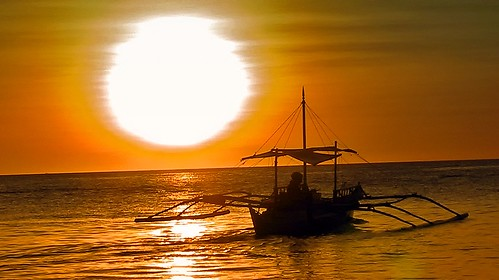 sunset beach boat philippines tropical boracay