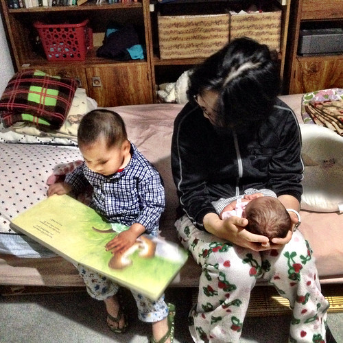 Reading a bedtime story for baby sister