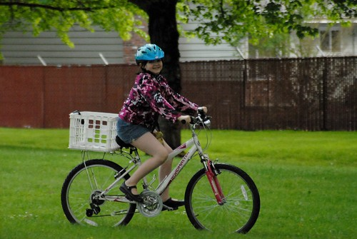 girl biking in park