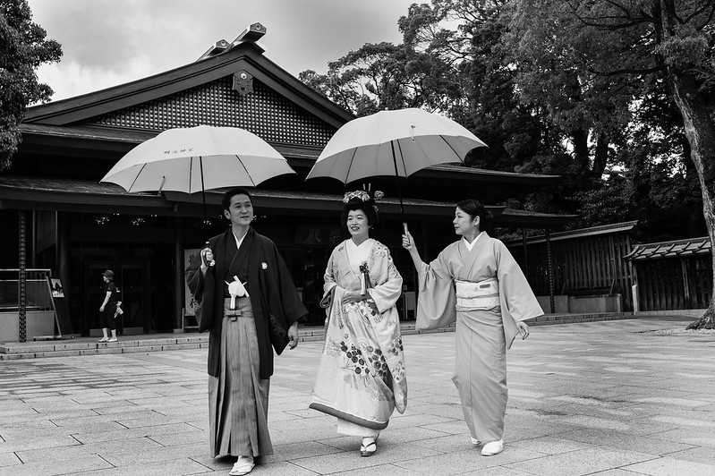 A bride and groom walks down Meiji Shrine where their traditional wedding will be held.