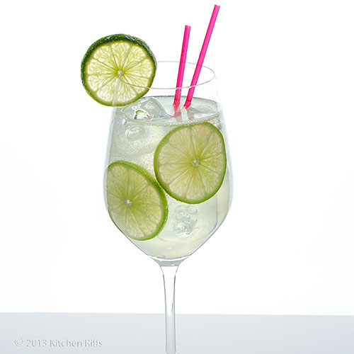 Gin Rickey Cocktail in wine glass with lime garnish