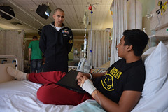 Personnel Specialist 1st Class Jay Jay Robles visits a patient at the Royal Alexandra Hospital for Children in Sydney, July 31. (U.S. Navy photo by Mass Communication Specialist 3rd Class Paul Kelly)