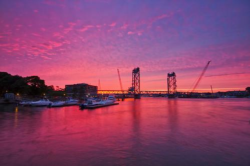 ocean longexposure bridge sunset water evening daylight day cloudy newengland newhampshire portsmouth coastline memorialbridge piscataqua portsmouthharbor robertallanclifford cliffordphotographynhcom