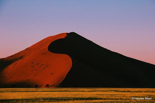 red sky sun nature sunrise canon dawn landscapes scenery desert dunes sesriem namibia sossusvlei namib 550d hannessteyn canonefs18200mmf3556is canon550d eosrebelt2i