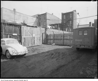 VW Beetle parked outside garage on Augusta Avenue