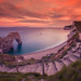 Durdle Door at Sunset by chasingthe_stars