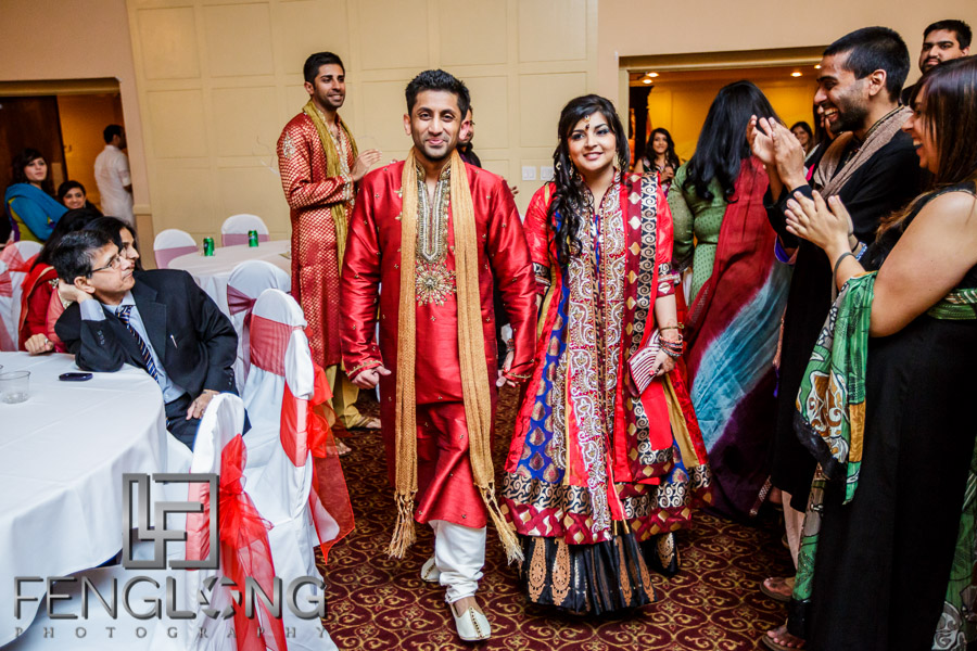 Indian bride and groom entering banquet hall during Pithi night