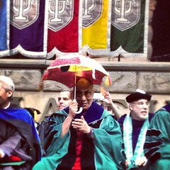 The Dalai Lama celebrates commencement with a second line umbrella! #onlyattulane