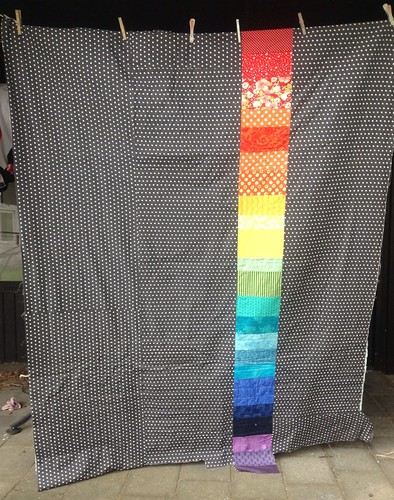 Background of Dresden flower quilt. Lots of polka dots and a rainbow...