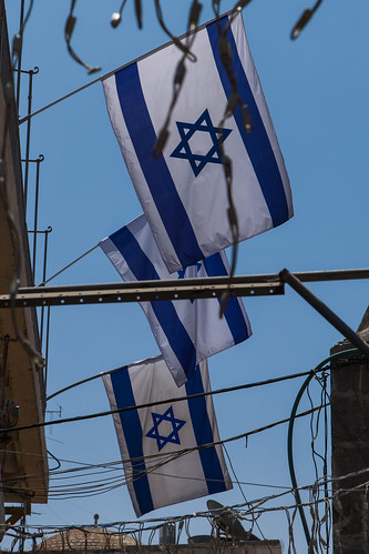 https://www.twin-loc.fr  Jerusalem old town, Israel - Flags in the blue sky picture image photo