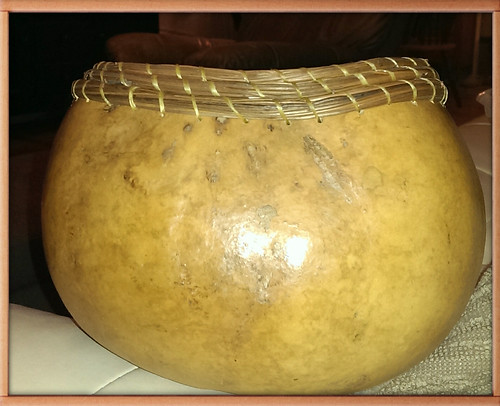Gourd bowl with coiled pine needle rim