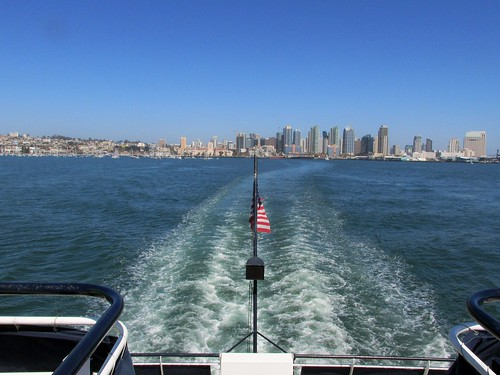 An aft view of the San Diego city skyline aboard a harbor sightseeing cruise.  San Diego california.  June 2013. by Eddie from Chicago